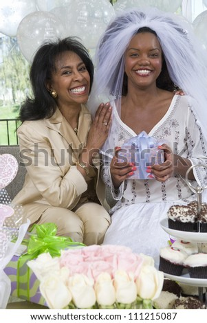 Portrait of happy bride and her mother at party