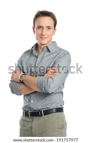 Portrait Of Happy Businessman With Arm Crossed On White Background
