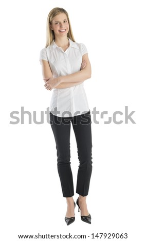 Portrait of happy businesswoman standing arms crossed against white background