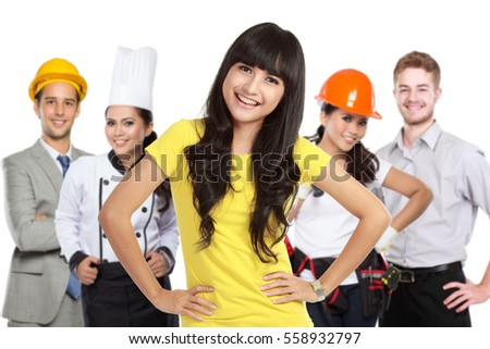 portrait of happy customer standing in front of her house contractor or builder