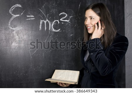 portrait of happy cute student in classroom at blackboard back to school having fun