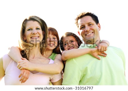 Portrait of happy family giving children piggy back rides