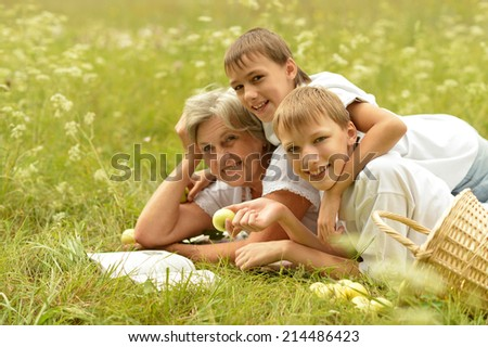 Portrait of  happy family in summer forest