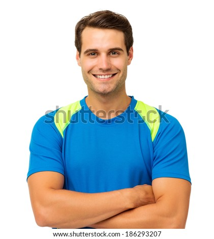Portrait of happy fit man with arms crossed isolated over white background. Horizontal shot.