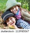 Portrait of happy girl and boy  enjoying golden autumn fall season - stock photo