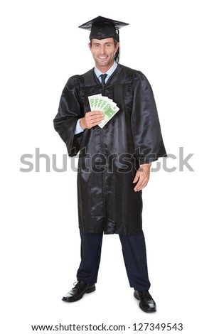 Portrait of happy graduate student with cash. Isolated on white