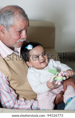 portrait of happy grandfather and grand daughter, grandfather and grandchild
