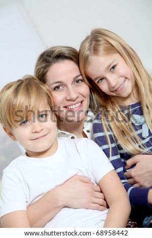portrait of happy mother with 2 blond children