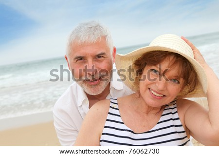 Portrait of happy senior couple on a sandy beach