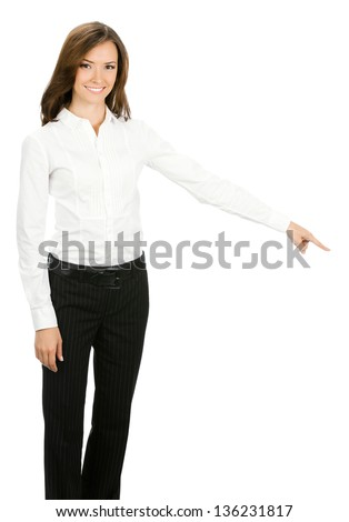 Portrait of happy smiling beautiful young cheerful business woman showing something, isolated over white background
