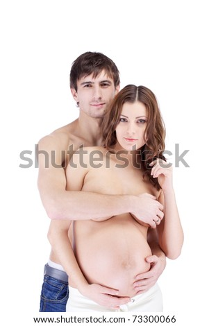 Portrait of happy smiling couple embracing, woman pregnant