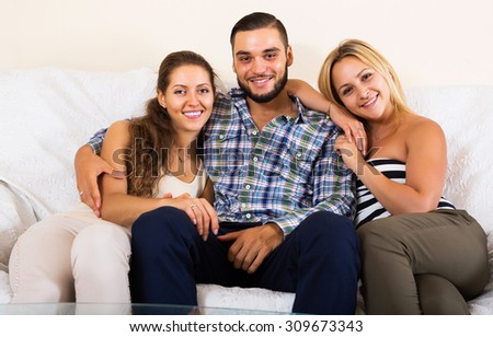 Portrait of happy two charming girls with boyfriend