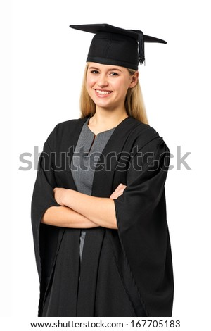 Portrait of happy university student in graduation gown standing arms crossed against white background. Vertical shot.