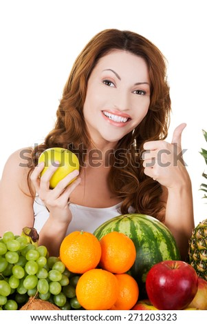 Portrait of happy woman with fruits.