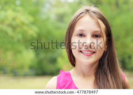 Portrait of little girl in the park