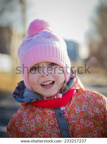 Portrait of little girl in winter clothes