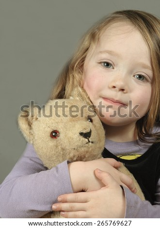 Portrait of little girl with vintage teddy bear