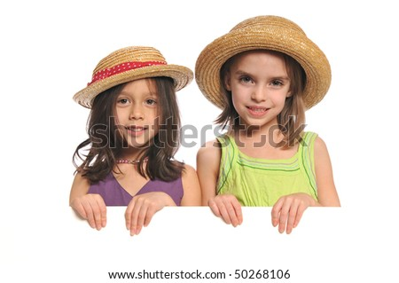 Portrait of little girls holding a blank sign isolated on a white background