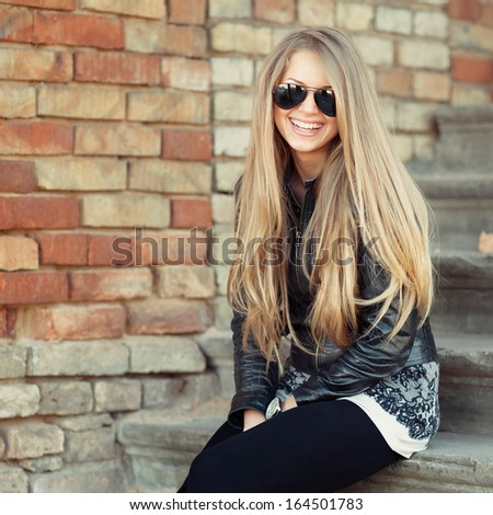 Portrait of lovely woman in sunglasses
