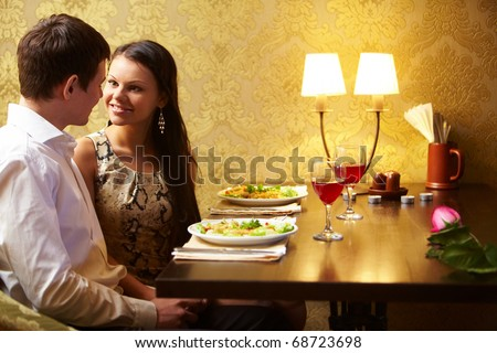 Portrait of man and woman looking at each other at meeting