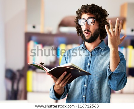Portrait Of Man Reading Book at a library