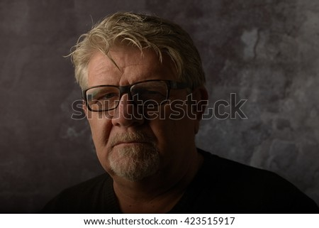 portrait of man with glasses. studio shot