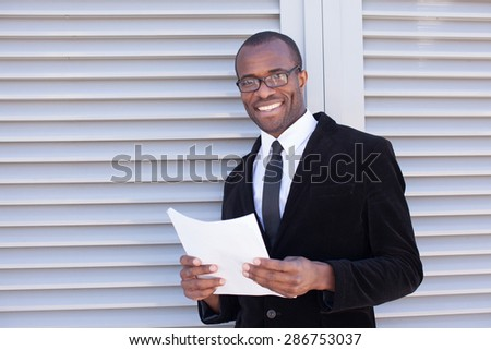 portrait of manager with papers