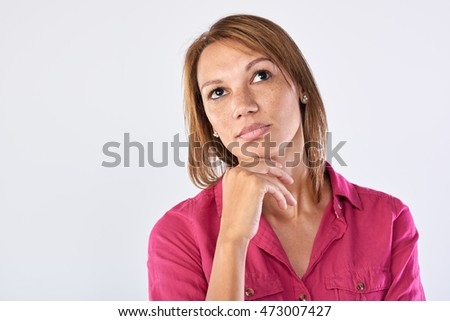Portrait of middle age business executive woman in thought, thinking brainstorming in studio