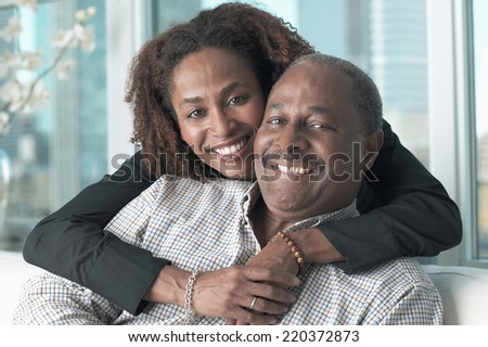 Portrait of middle-aged couple smiling