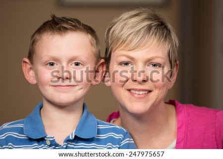 Portrait of mother and young son smiling.
