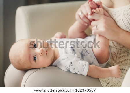 portrait of Mother playing with baby. Happy family with newborn
