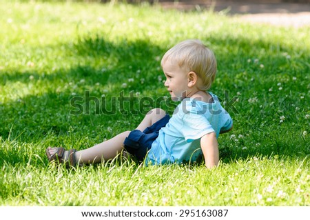 portrait of playing boy on grass in garden