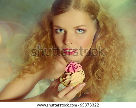 Portrait of pretty girl eating cake, retro style