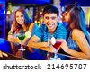 Portrait of pretty girl flirting with guy at party in the bar - stock photo