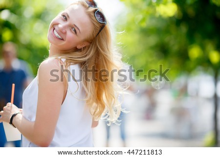 Portrait of pretty girl with cup of drink