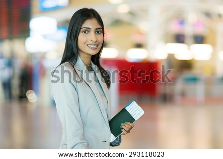 portrait of pretty indian female business traveller at airport
