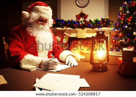 Portrait of Santa Claus answering Christmas letters
