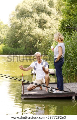 Father fishing son on bridge mountain stock photo for Old wife fish
