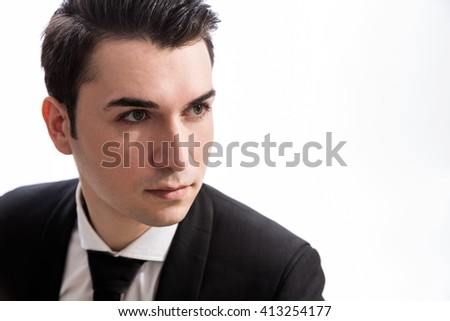 Portrait of serious caucasian businessman looking away from the camera, dressed in suit and isolated on white background