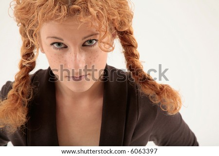 portrait of serious looking curly redhead