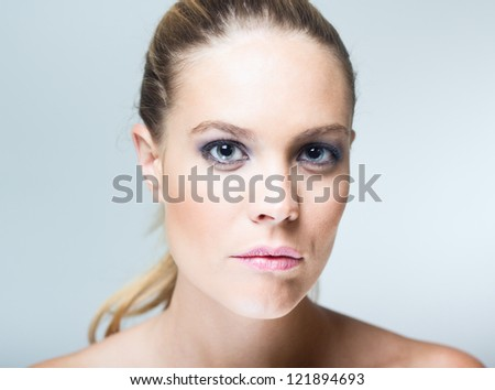 Portrait of sexy beautiful young woman with clean skin on a white background
