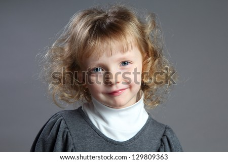 Portrait of small charming girl.