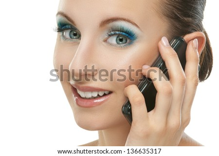 Portrait of smiling beautiful young woman with phone isolated on white background.