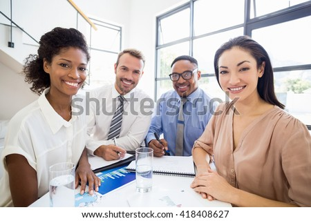 Portrait of smiling businesspeople during a meeting in office