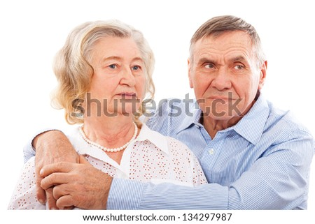 Portrait of smiling elderly couple. Closeup, isolated on white.