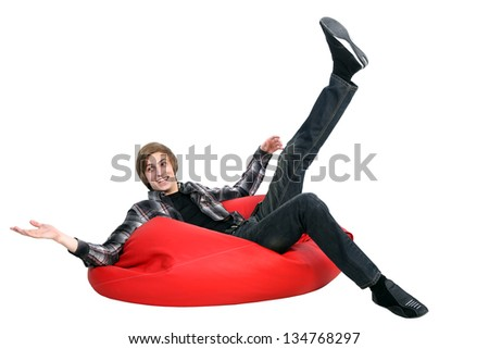 Portrait of smiling man sitting on bean bag. White background.