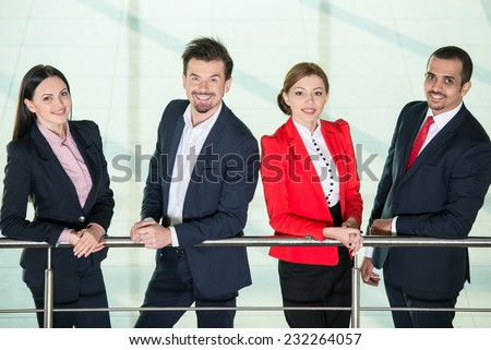 Portrait of smiling, successful international business people team.