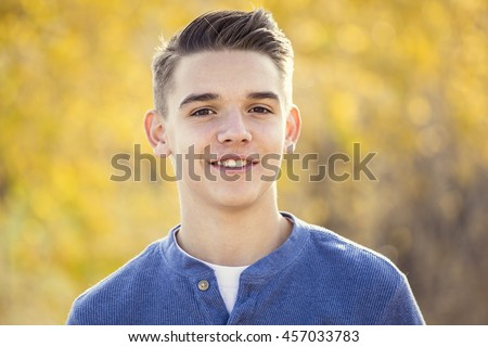 Portrait of smiling teen boy outdoors. Boy looking at the camera with a handsome smile on his face