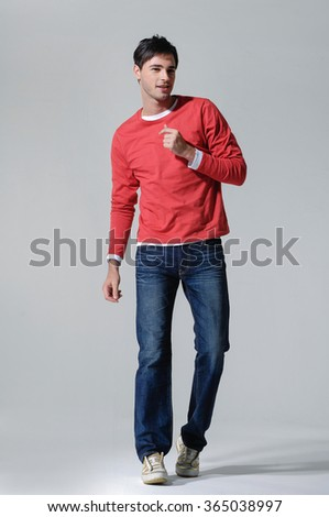 portrait of smiling walking man casuals in studio