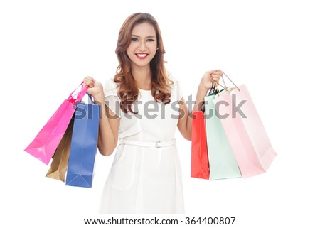 portrait of smiling young woman with shopping bags isolated on white background
